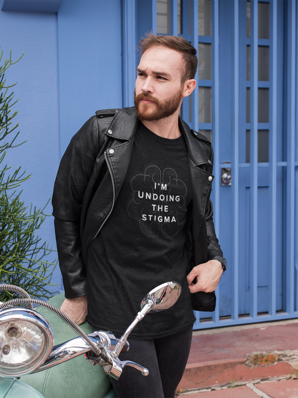 I'm Undoing the Stigma Mindfulness - Black Unisex mental health awareness T-shirt worn by a male model posing outdoors