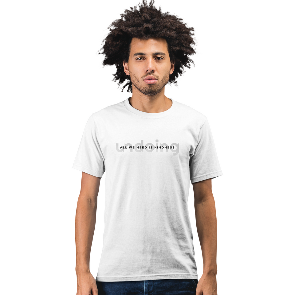 Male model wearing All We Need is Kindness Gradient Fade - Unisex T-Shirt White Tee by Undoing