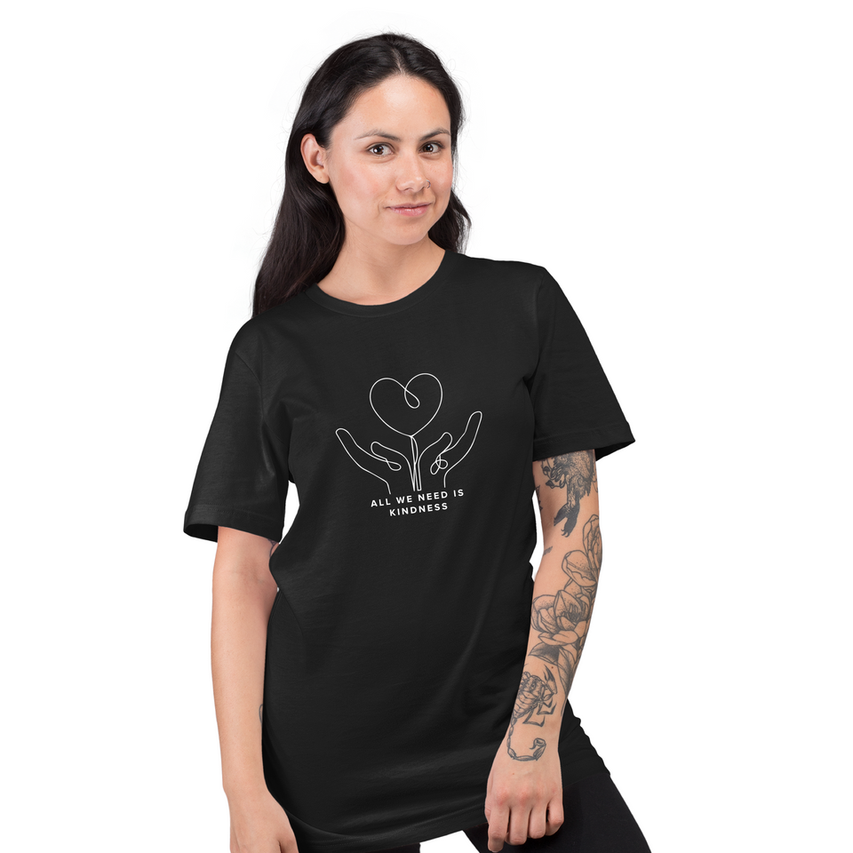 Female model tattoo posing while wearing All we need is kindness Doodle - Black Unisex tshirt