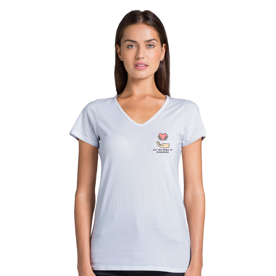 Female model wearing All We Need Is Kindness Pocket Tee - Women's Casual V-Neck T-Shirt White tee by Undoing