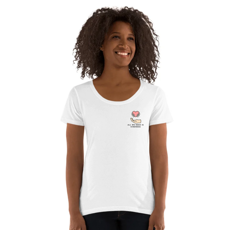 Female model wearing All We Need Is Kindness Pocket Tee - Ladies' Scoop Neck T-Shirt by Undoing