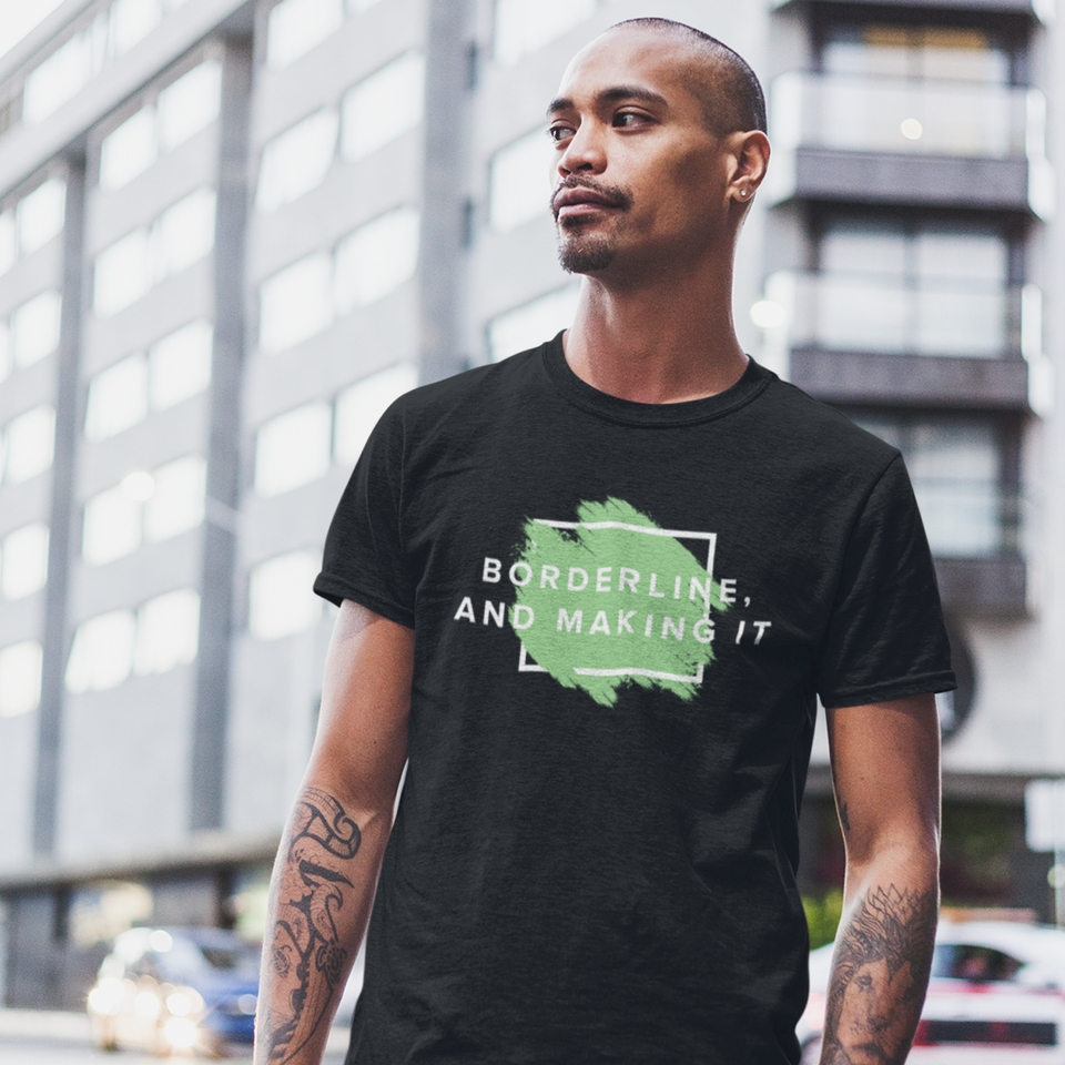 Man outdoors wearing Borderline, and Making It - Unisex Tee mental health awareness tee by Undoing