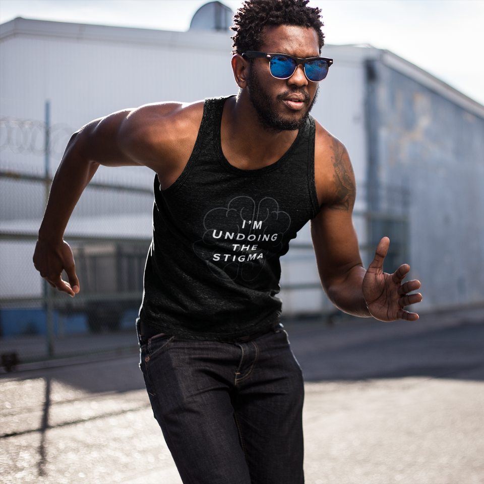Male model wearing I'm Undoing the Stigma Mindfulness - Unisex Tank Top black mental health awareness tank top by Undoing