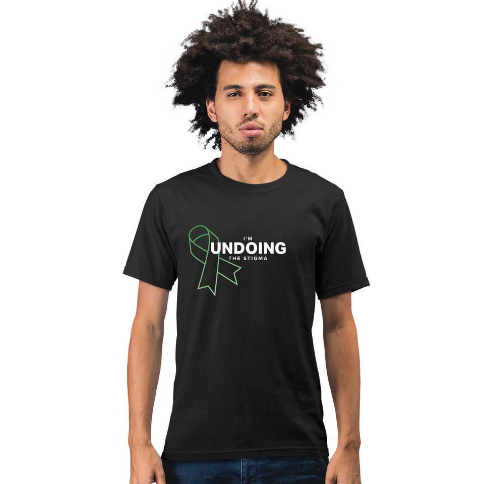 I'm Undoing the Stigma Mental Health Symbol - Black Unisex mental health awareness T-shirt worn by a male model posing indoors