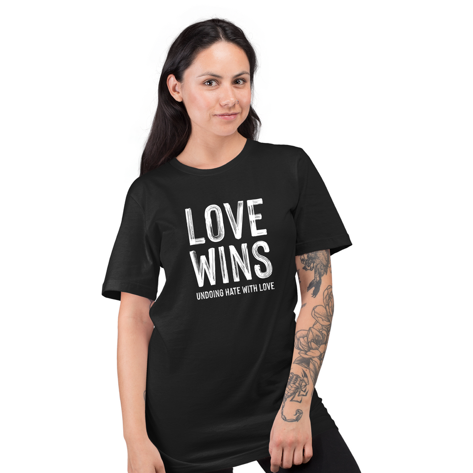 Love Wins - Unisex T-shirt by Undoing worn by a female model