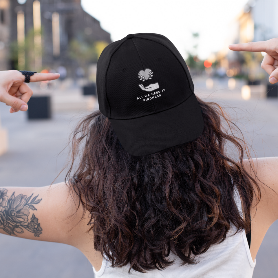All We Need is Kindness Baseball Cap mental health awareness hat by Undoing worn by a female model