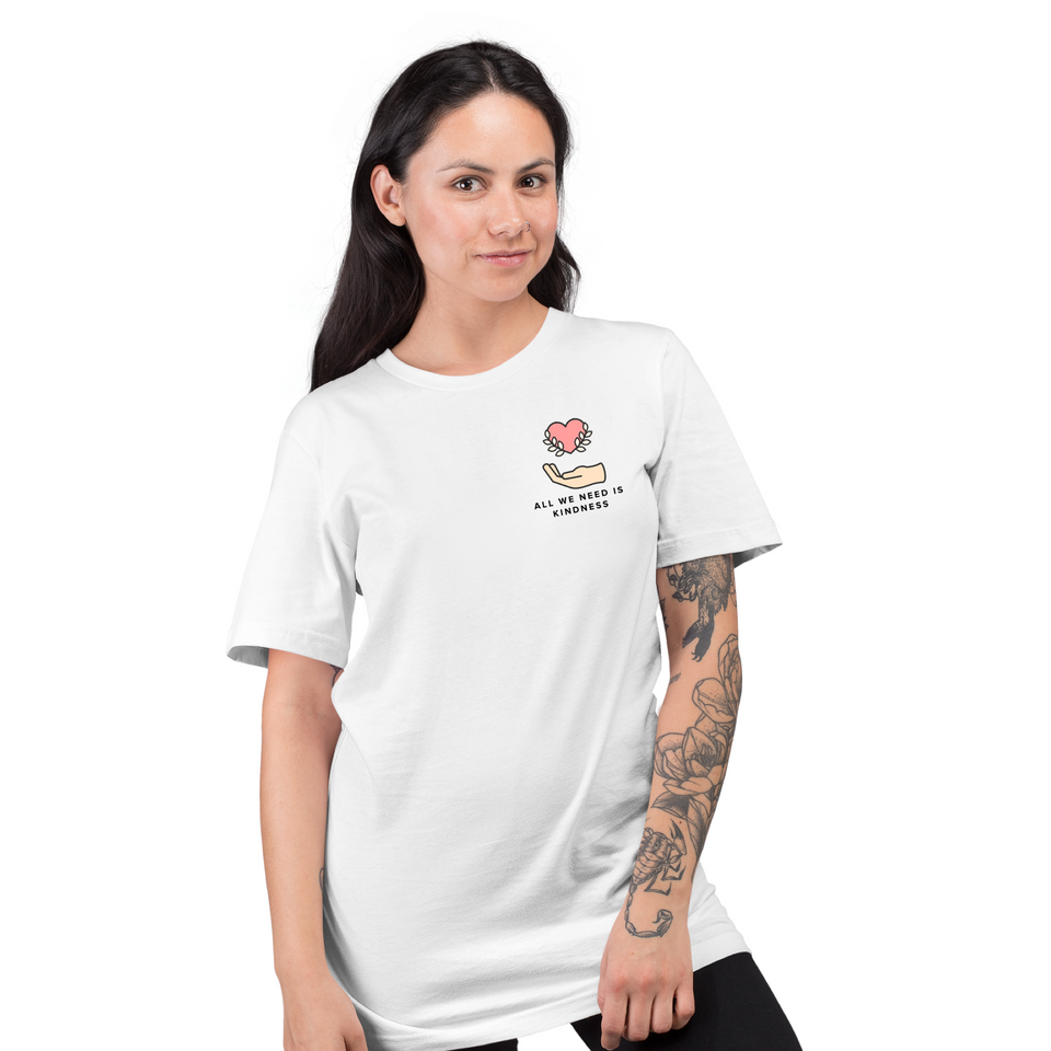 Female model wearing All We Need is Kindness Pocket Tee - Unisex T-Shirt White tee by Undoing