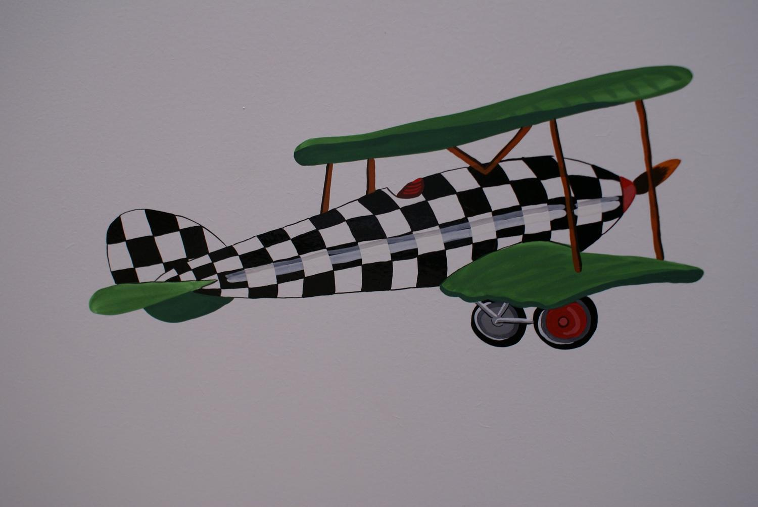 Flying airplane with Vintage Transport themed hand paintings | Dragons of Walton Street