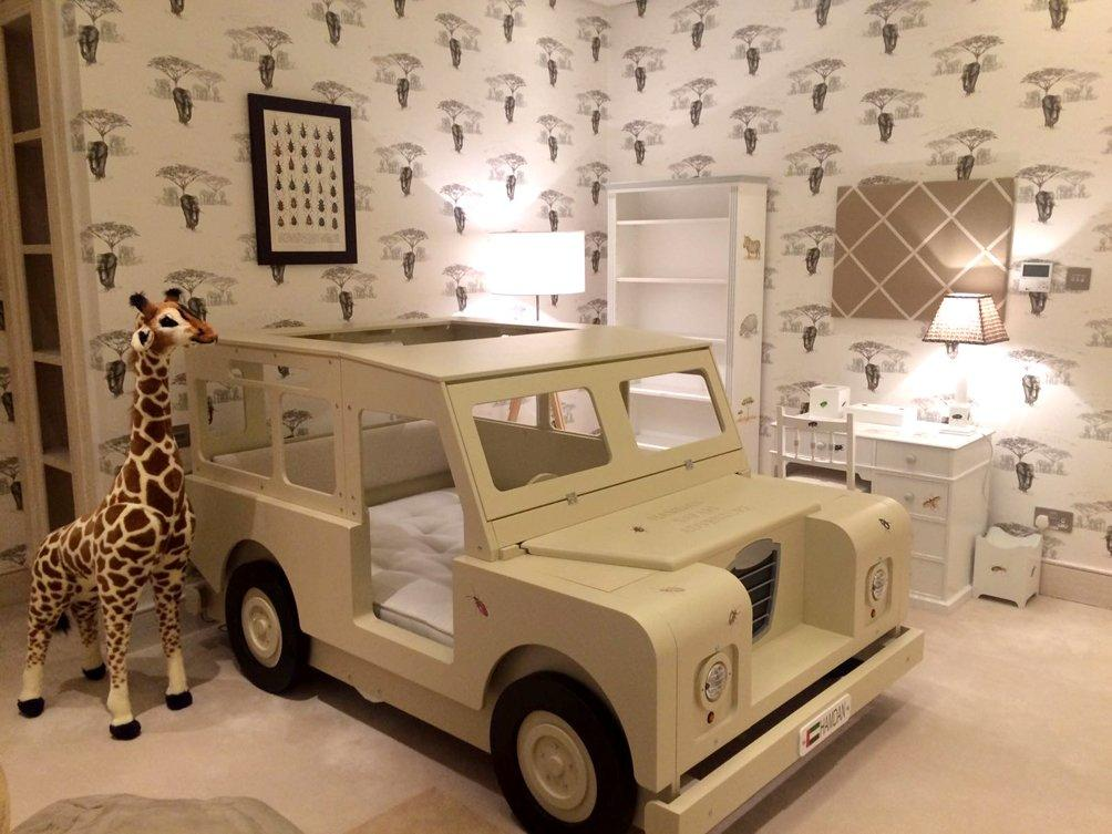 Safari themed children's room with accessories and bespoke jeep bed