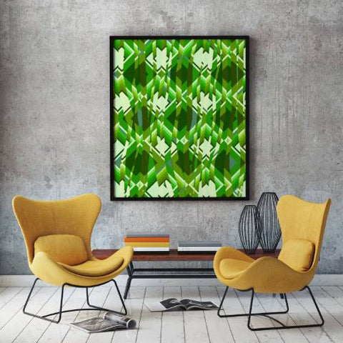 Retro style framed poster art in front of two orange chairs and a coffee table