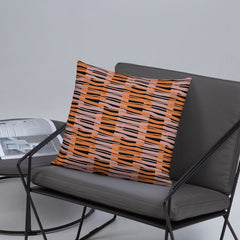 Orange and pink criss-cross fibres alternate in a checked pattern with a black background in this sofa pillow cushion by BillingtonPix