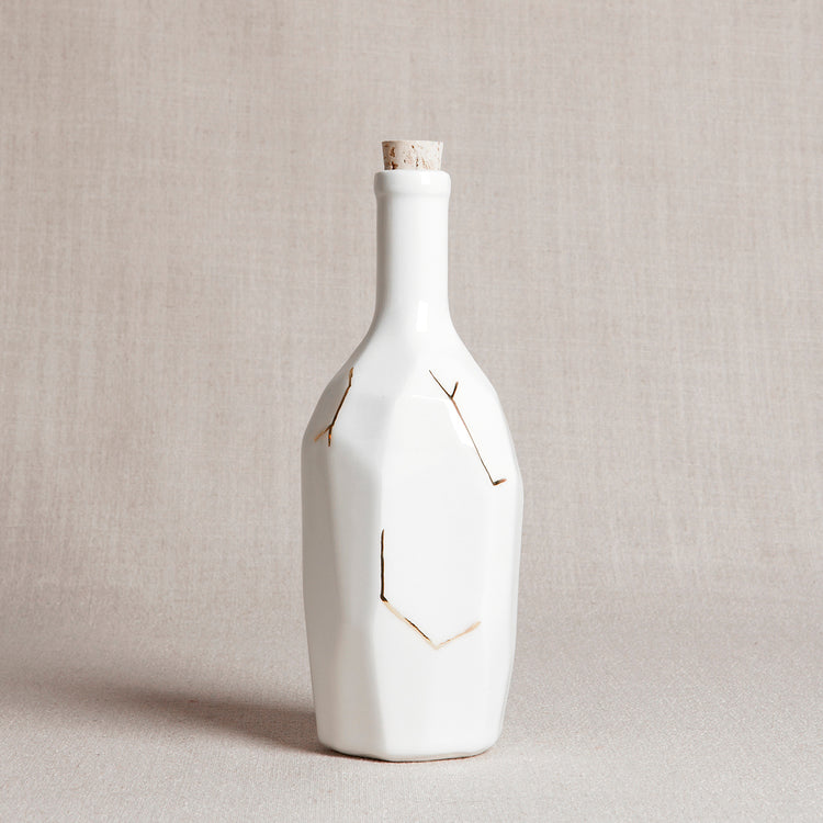 White Faceted Bottle with Gold Details