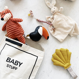 Toys and stuffed animals inside the baby bag couture.