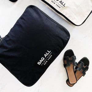 Double sided packing cubes in black and white for you clothes and shoes.