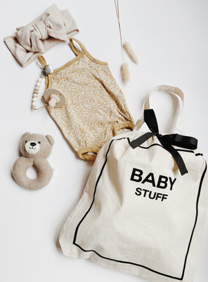 Baby clothes in a baby organizing bag.