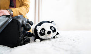 Panda Snuggle Glove Travel Pillow for Kids on Bed