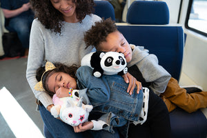 Panda Snuggle Glove Travel Pillow for Kids on train