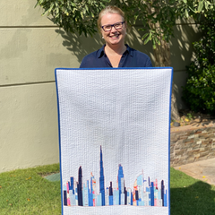 Janelle from Dotty and Grace with the Dubai Skyline Quilt