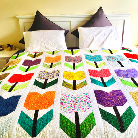 Totally Tulips quilt in its new home - photo courtesy of @NetteP