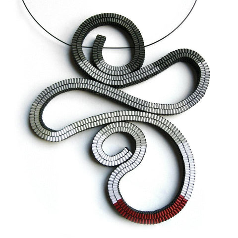 Abstract shaped necklace made of red, silver and gray paper