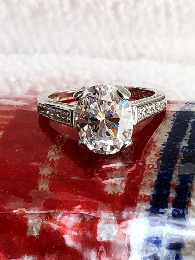 3.5 Carat Oval CZ Engagement Ring with pave set small side stones