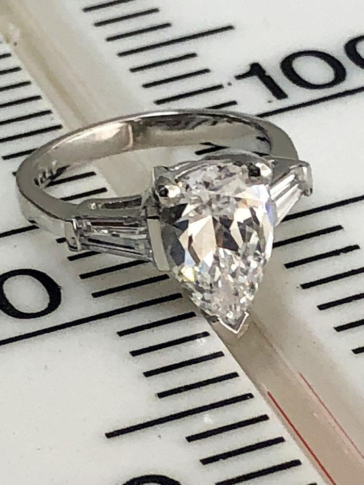 3 carat Pear shape cz tapered baguettes on the sides 14k white gold