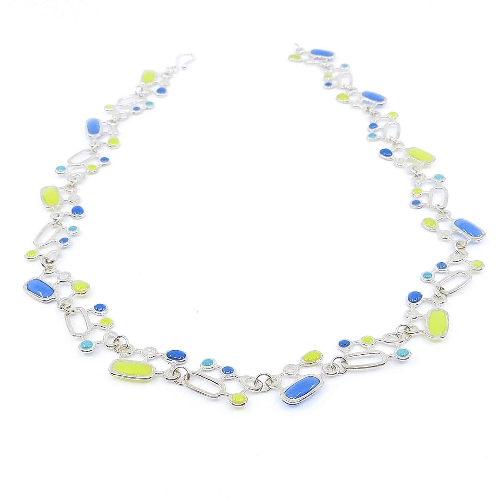 Sterling silver organic geometrics link necklace with apple green, blue, and turquoise resin inlay.