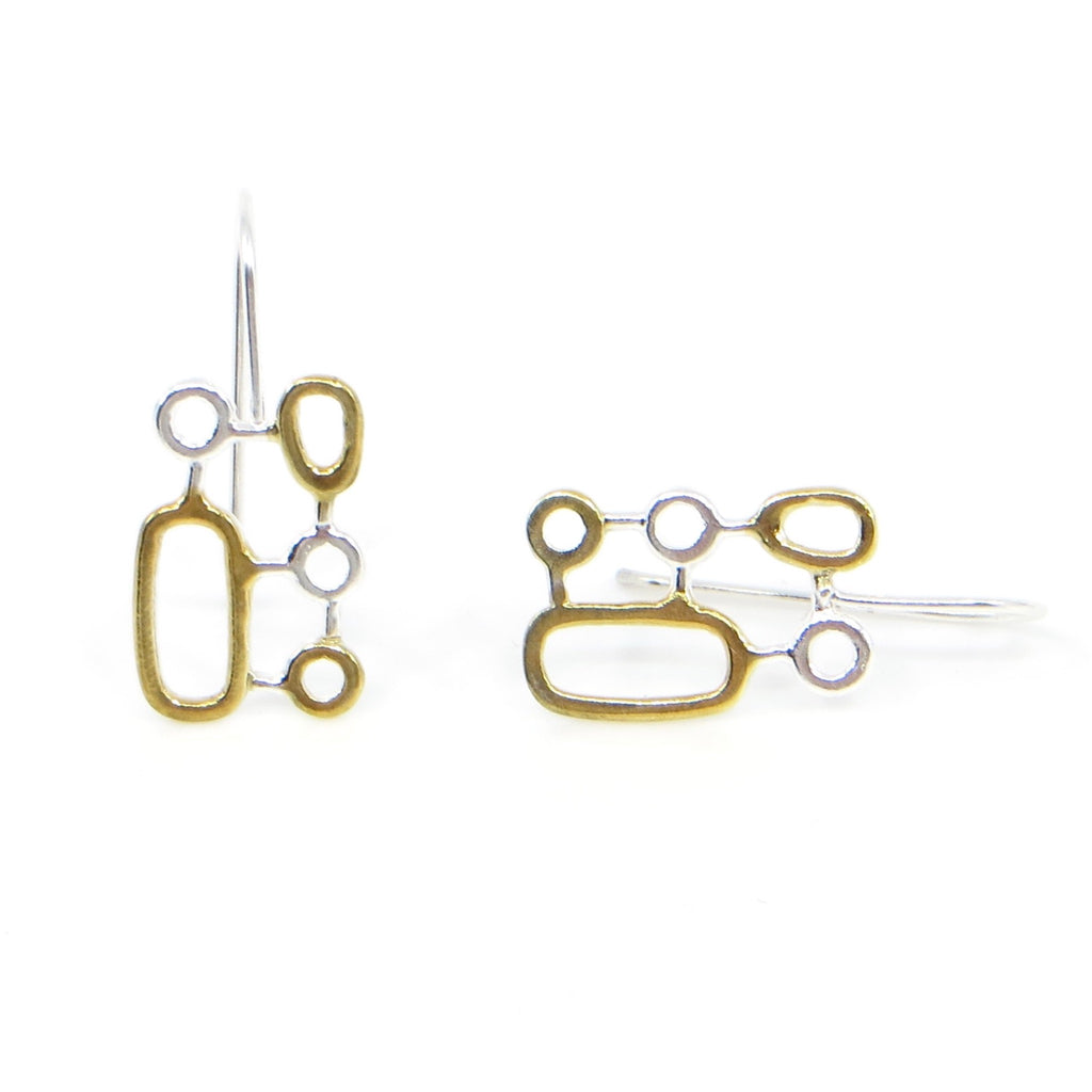 Organic geometrics earrings of sterling silver and 18k yellow gold plated on some of the shapes.