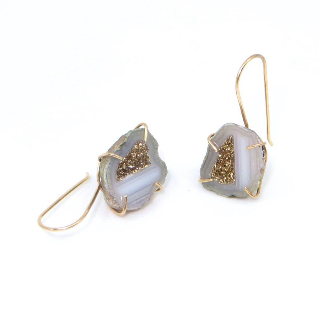 Split mini grey and gold geodes with  18k gold on center crystals.  14k gold frame dangle settings.