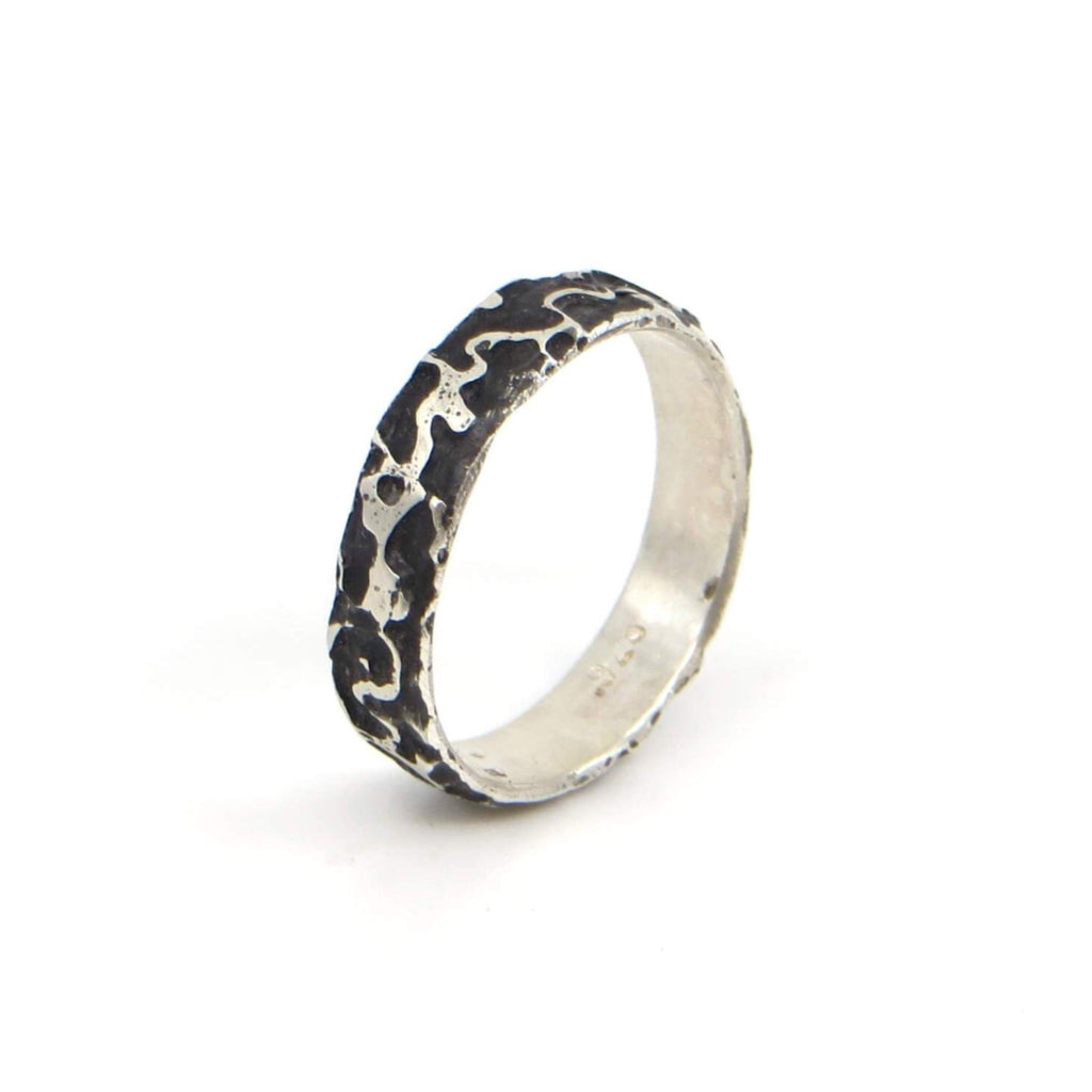 Etched Sterling silver ring with organic pattern.  Black patina is in the recesses.  US Size 7.