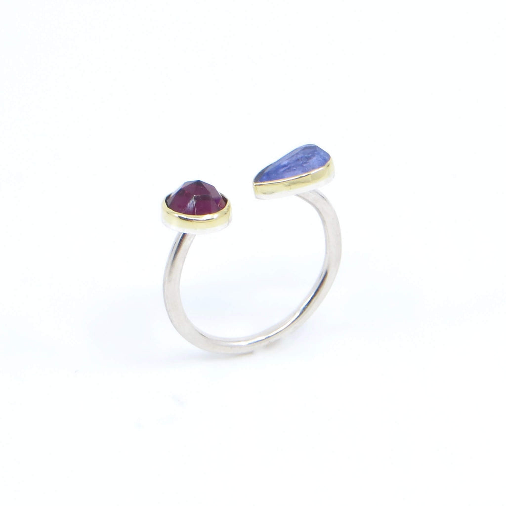 Rose cut round garnet and rose cut pear tanzanite open top ring. 18k royal yellow gold bezels. Sterling silver round band.  Diagonal View.