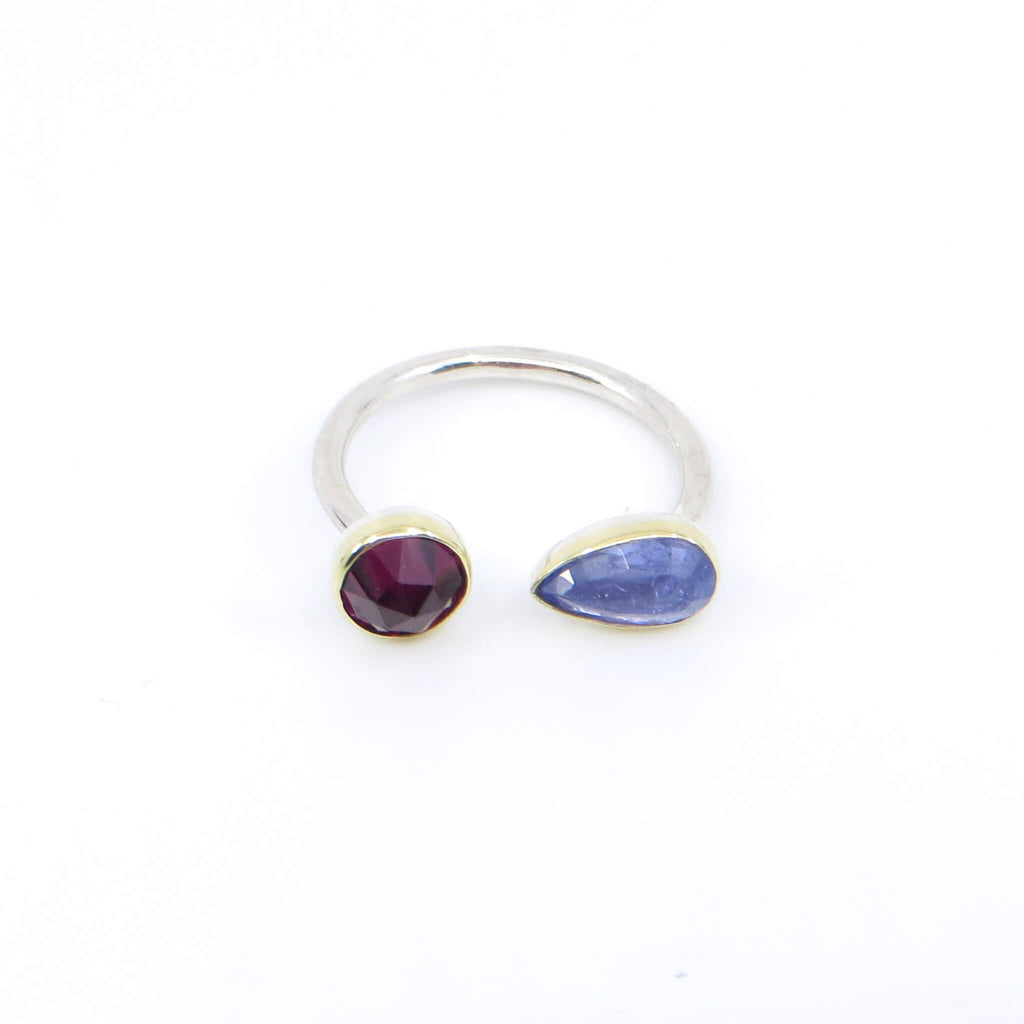 Rose cut round garnet and rose cut pear tanzanite open top ring. 18k royal yellow gold bezels. Sterling silver round band. Front View.