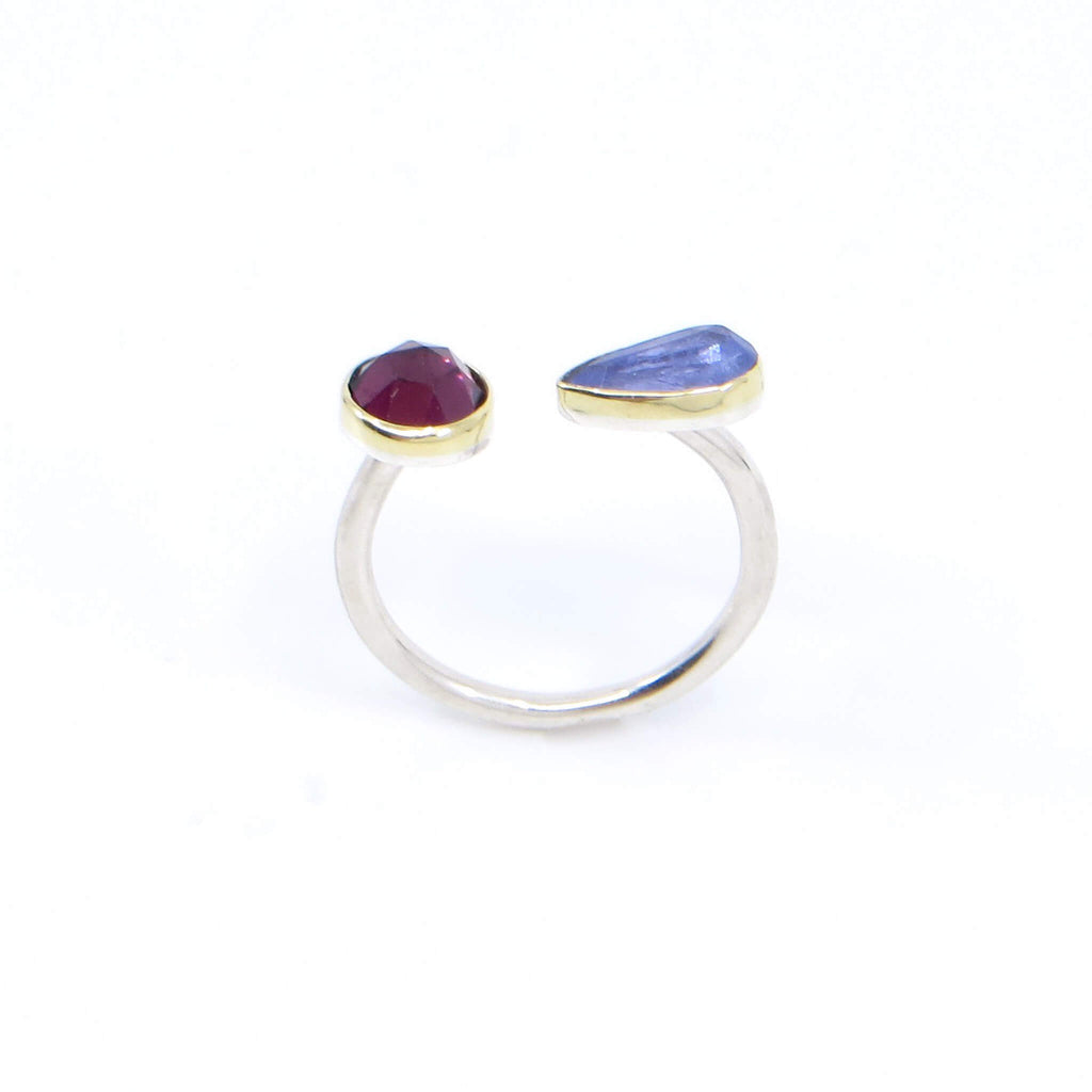 Rose cut round garnet and rose cut pear tanzanite open top ring. 18k royal yellow gold bezels. Sterling silver round band. Finger through view.