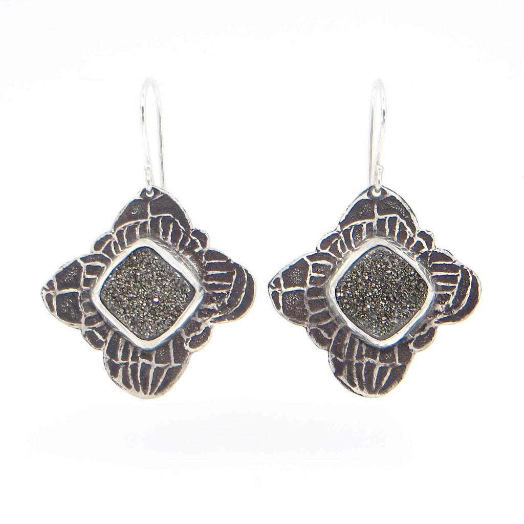 Silver mist square drusy stones bezel set on etched silver and black patina back  earrings.  Squares hang diagonally.