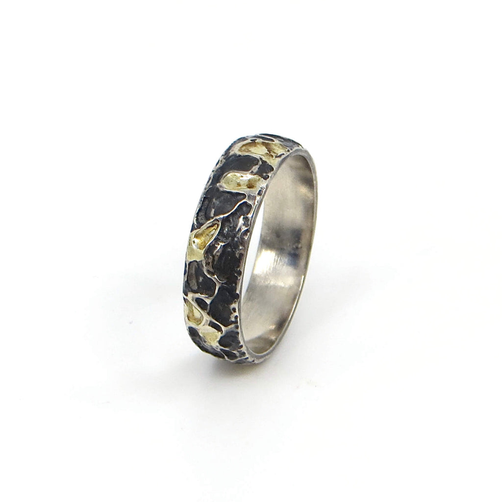 Etched sterling silver ring with organic raised pattern.  Black and 18k gold in the recesses. US Size  7.