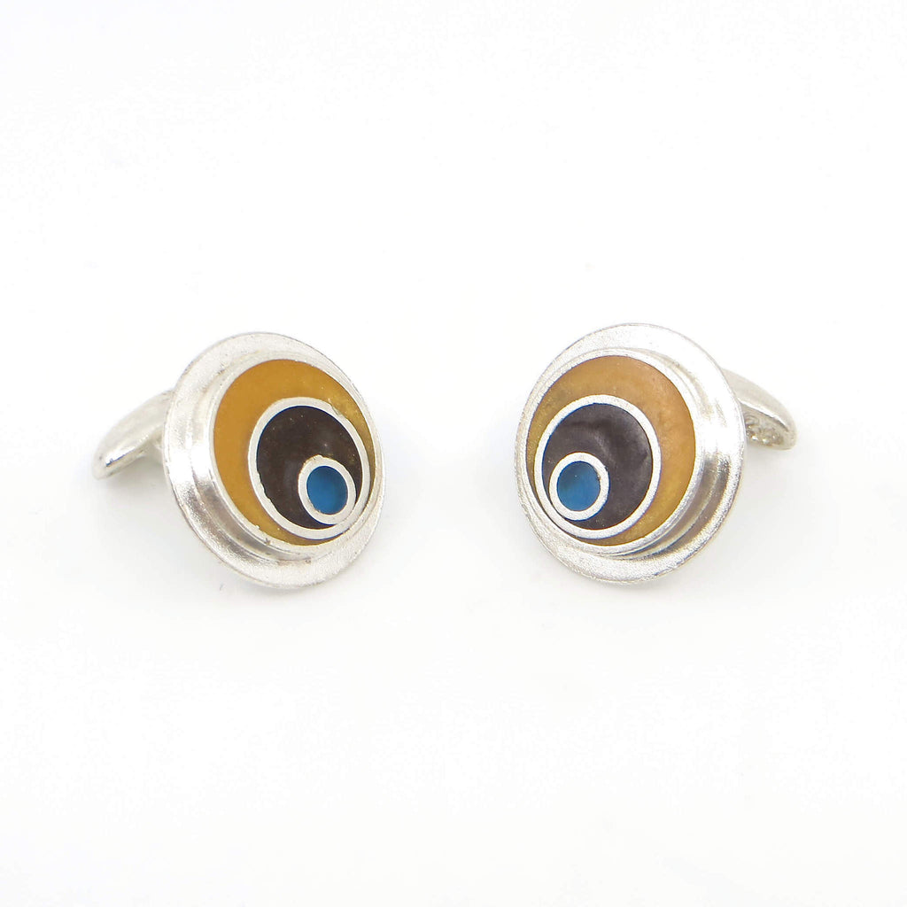 Sterling silver and resin inlay cufflinks. Maize outer ring, chocolate brown middle ring, blue dot.