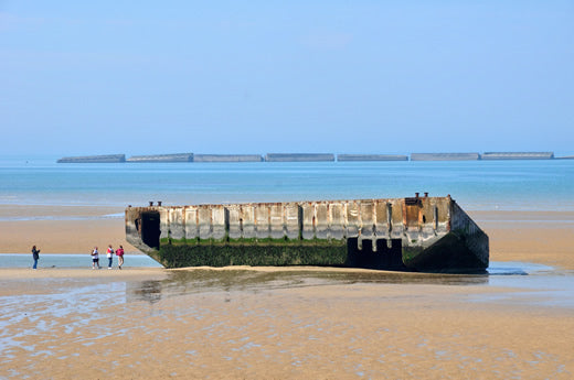 On the beach at the artificial harbor at Arromanches in Normandy, France..