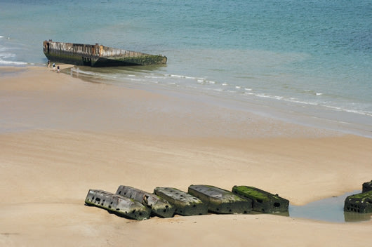 A view from the beach of left over pieces of the artificial harbor at Arromanches in Normandy, France.
