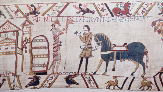 An image of two figures talking to one another as displayed in the Bayeux Tapestry.