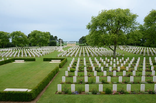 The columns of gravestones at the Canadian Cemetery in Beny-sur-Mer, France.