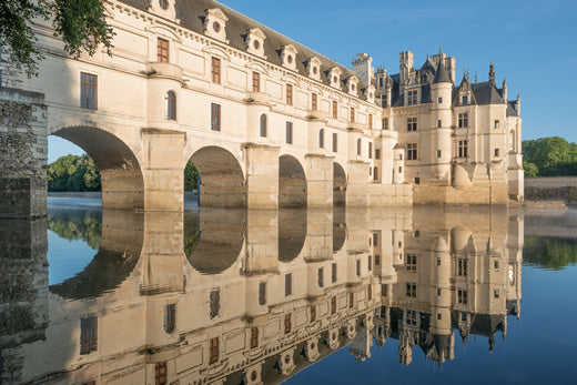 Chenonceau castle reflected in the water.