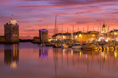 An image of La Rochelle from the harbor at sunset.