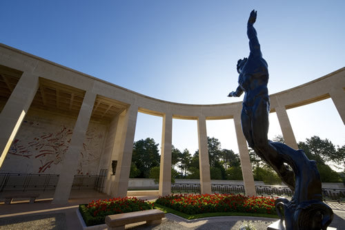 A statue in the center of the memorial at the American Cemetery at Colleville Sur Mer.