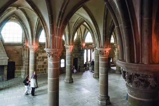 Tourists visit the interior of Mont St. Abbey in France.