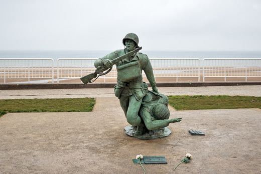 Statue of American soldiers at Omaha Beach in Vierville Sur Mer, France
