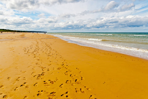 A contemporary view of Omaha beach looking serene and calm.
