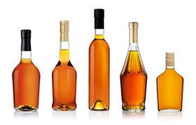 Unlabeled battles of Cognac in different shapes and sizes.