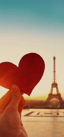 A paper heart in front of the Eiffel Tower in Paris, France.
