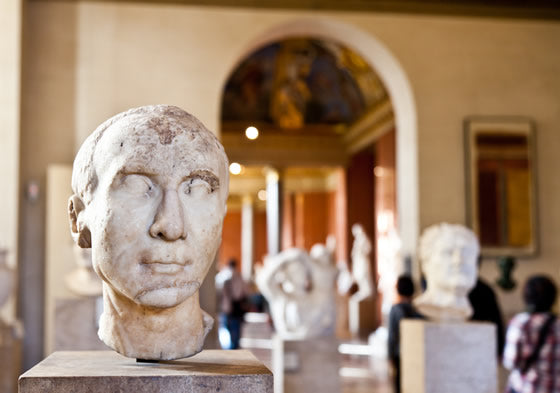 Marble statue heads in the Louvre Museum in Paris.