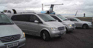 Mercedes-Benz airport transfer vehicles at Charles de Gaulle airport in Paris..